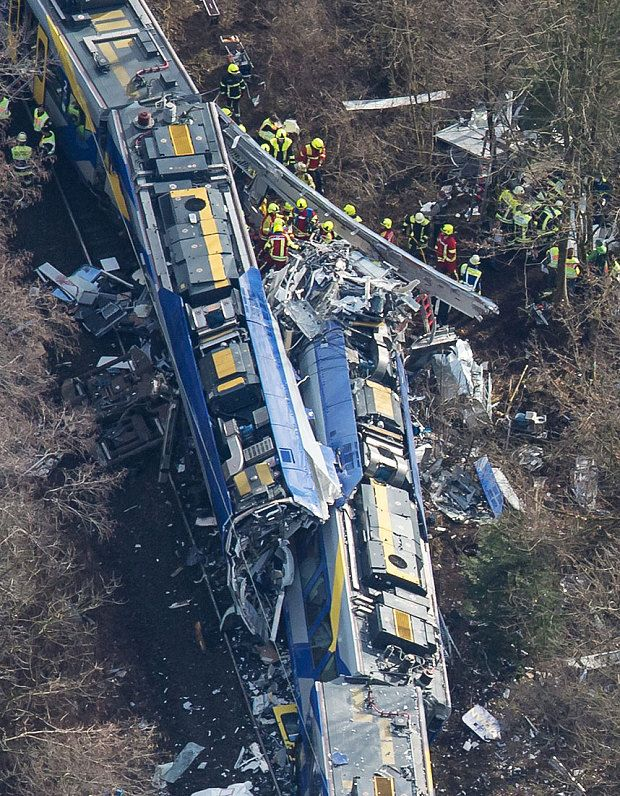 "(Pin 19 | Test set A-1):  German train crash: 'At least ten' killed and 150 injured in Bavaria | Firefighters and emergency doctors work at the site of a train accident near Bad Aibling | ... ""a tragic accident occurred on the single-track route between Rosenheim and Holzkirchen ... 
