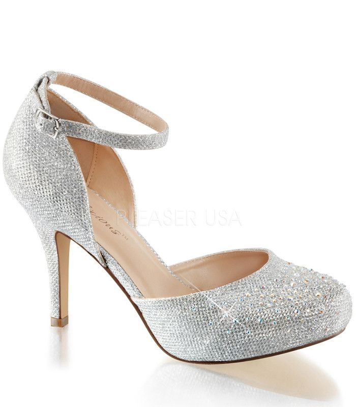 """Silver Sparkle Covet Ankle Strap Pumps by Fabulicious. Shoes are perfect for a night on the town. Adjustable ankle strap and closed toe detail. These classic slip on pumps have a 3 1/2"""" heel and a 1/2"""
