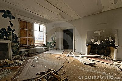 Inside view of an abandoned house with debris and damaged decoration in Ivittuut Greenland
