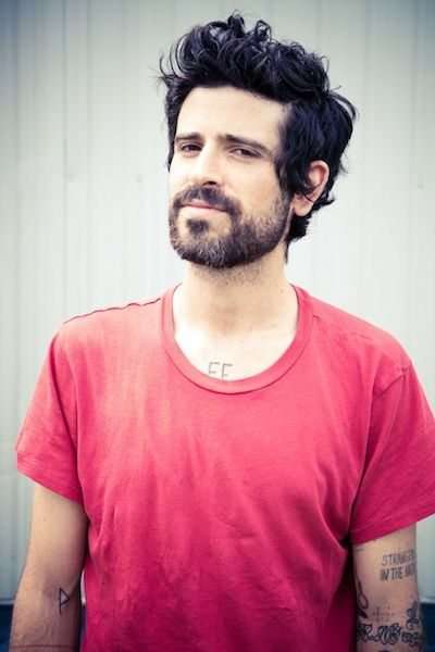 You can't tell me Devendra Banhart doesn't look like Justin Thoreaux's edgy little brother.