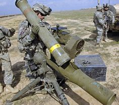 US Army soldiers set up a BGM-71 TOW anti-tank missile launcher station.