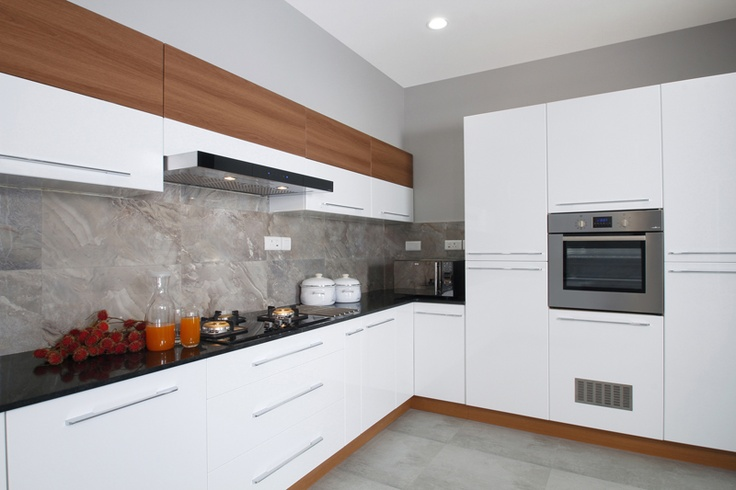 Kitchen Tall Unit with Built-in Oven - Skyline Ivy League        SAVIO and RUPA Interior Concepts Bangalore | professional apartment interior designers Bangalore | Modern villa Interior Designers | Residential Interior Designs