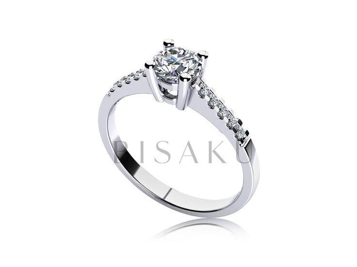 C11 Působivý zásnubní prsten, který zdobí do hranatých krapen usazený solitérní kámen, který je po obou stranách doplněn o deset menších kamenů. Prsten na ruce působí velmi jemně a elegantně. Jeho nositelce jej doporučujeme nosit na prsteníčku samotný, aby vynikla jeho křehkost. #bisaku #wedding #rings #engagement #svatba #zasnubni #prsteny