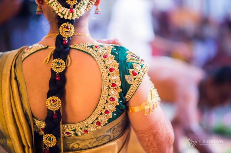 South Indian bride. Silk sari. contrast blouse. Braid with jewels.