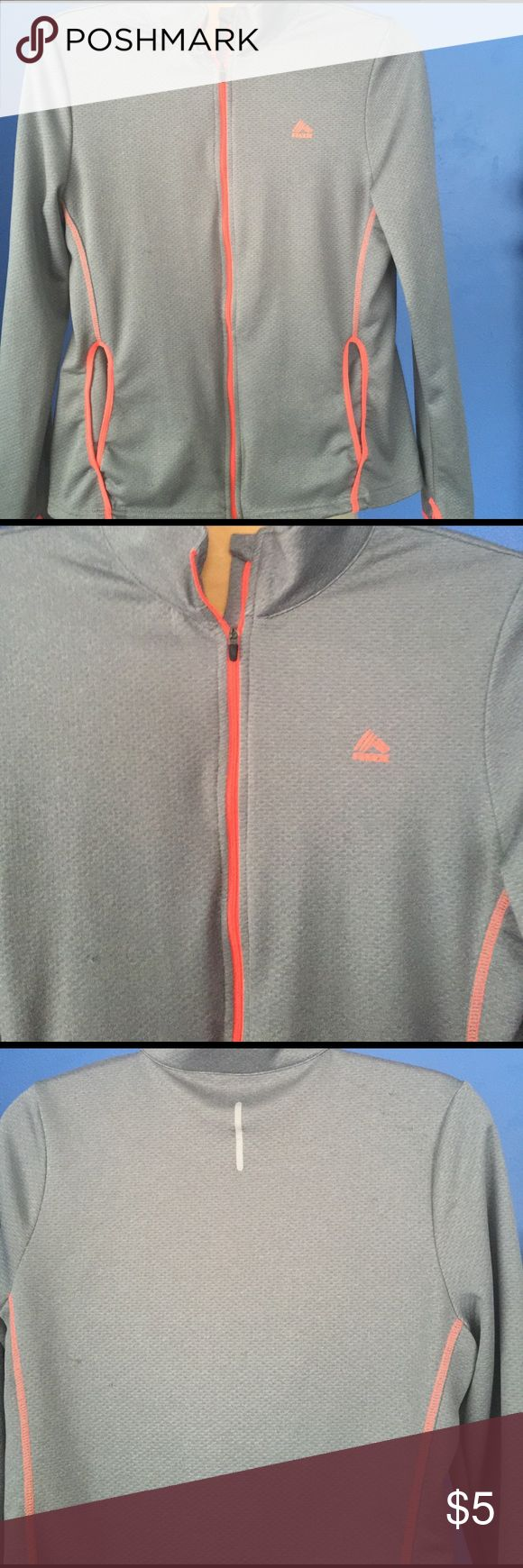 RBX grey zip front activewear jacket Womens grey zip up with orange trim. Size XL and has a couple of pulls. RBX Jackets & Coats