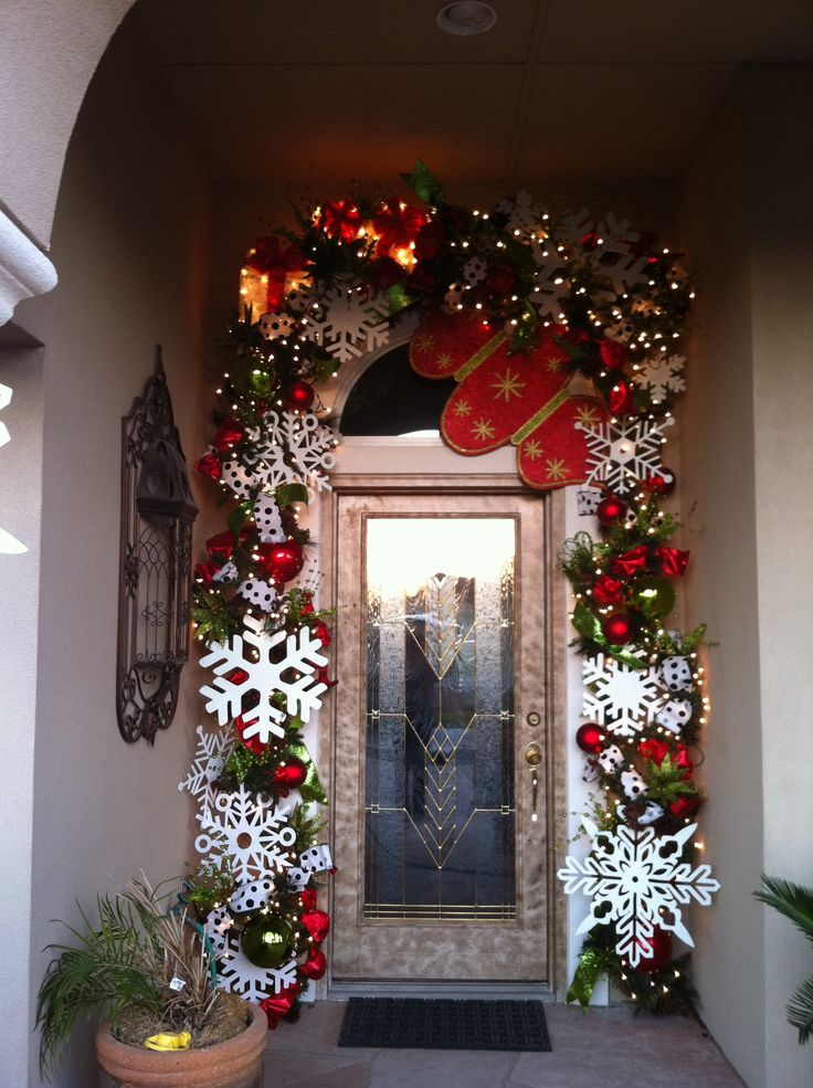 Winter Door Decor  I love using big snowflakes in outdoor designs