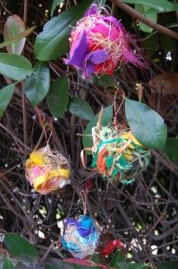 think of these as ornaments for springtime… to be hung outside on the trees in your yard so that birds can peck into them, between the wires, to retrieve lovely adornments for the nests they're building