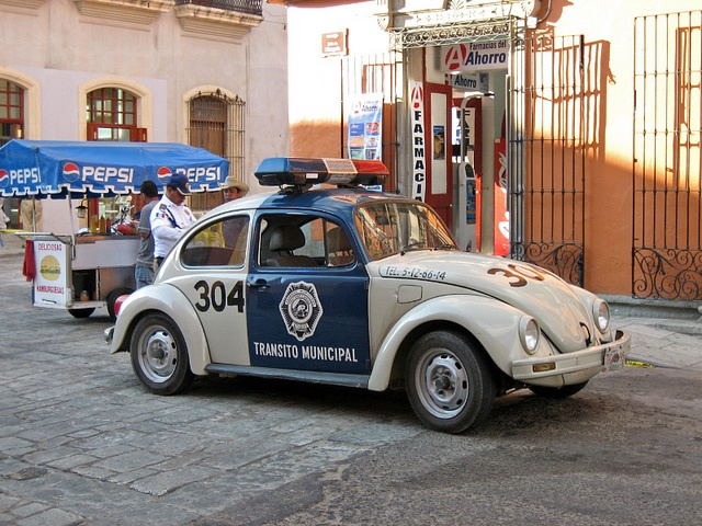Volkswagen -- [Mexican police beetle in Oaxaca City, Mexico.]~[Photograph by Olivier Brisson - October 16 2005]