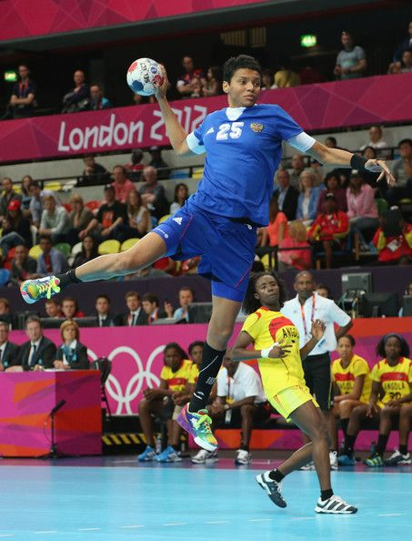 Emiliia Turei of Russia scores a goal in the Women's Handball preliminaries Group A - Match 1 between Russia and Angola on Day 1 of the London 2012 Olympic Games at the Copper Box on July 28, 2012 in London, England.