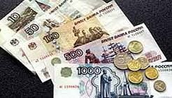 Economy-Here we can see different bills and coins of Russian Ruble laid out. One American dollar is equal to 39.92 Ruble. on the Russian Ruble there are lots of statues and pictures of people like Vladimr Lenin