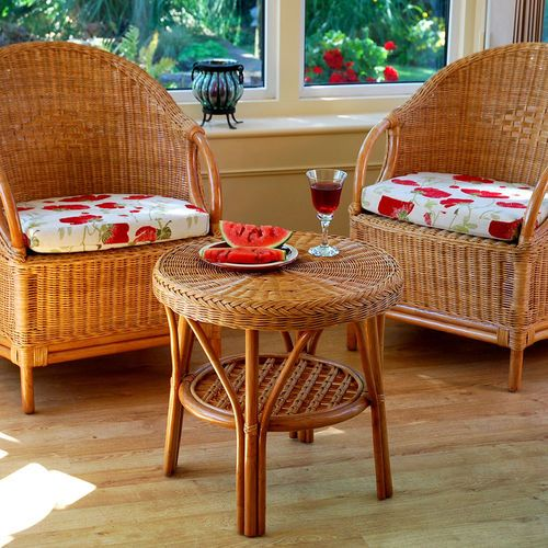 This striking Cambridge Breakfast Cane Table and Chair Set is truly modern with its Candy Brown finish. It's a great addition to any patio or breakfast room.   Take your tea out by the lawn on a summer's evening or transform your conservatory into a breakfast room, as the bistro table is large enough to hold glasses of orange juice and breakfast plates for two.