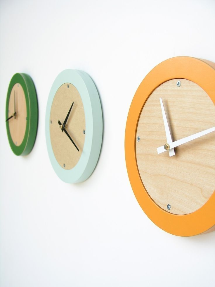 tangerine creamsicle modern wall clock by uncommon on Etsy