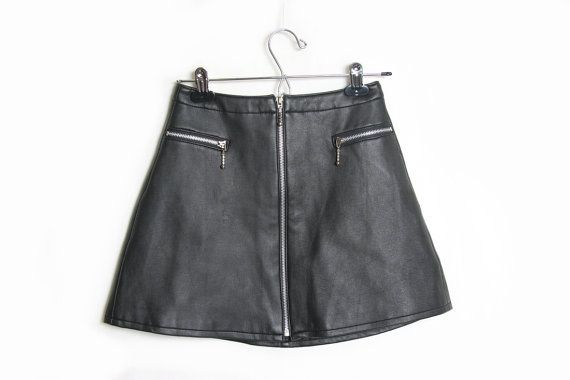 Very cute vegan leather mini skirt. High waisted fit Zipper pockets and Zipper in the front. Lined with nylon really comfy fit.  Tag - Cosa Nova Marked size- 5 Fits like a small - medium  Please check measurements for accurate fit  Waist 13 Hip 19 Width of bottom 22 Length 15  Dont hesitate to ask any questions you have =)  Please read shop policies before purchase. Contact me before purchase if you would like to buy tracking / insurance. =)