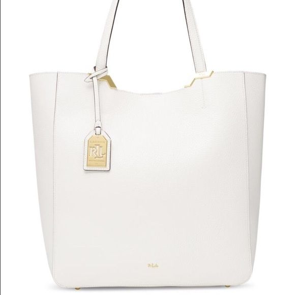 Lauren Ralph Lauren Tote LAUREN by Ralph Lauren Acadia Tote - Tote Handbags : Vanilla : Channel you inner diva to pull off this fierce smooth LAUREN by Ralph Lauren Acadia Tote. Made of synthetic material-faux leather.Magnetic snap closure. Dual flat carrying straps. Signature logo hardware detail in front. Protective metal foot base. Interior back-wall slip pocket. Imported. Measurements: Bottom Width: 12 in Depth: 4 1 4 in Height: 13 in Strap Length: 9 in Strap Drop: 20 in Weight: 15.8 oz…