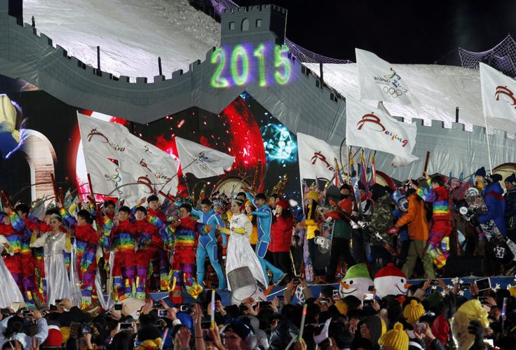 """New Year's Eve around the world Performers celebrate the arrival of the new year in front of the National Stadium, also known as the """"Bird's Nest"""", during a new year's countdown event to celebrate the arrival of the new year and in wishing winning the bid to host the 2022 Winter Olympic Games, in Beijing January 1, 2015. (REUTERS/Kim Kyung-Hoon)"""