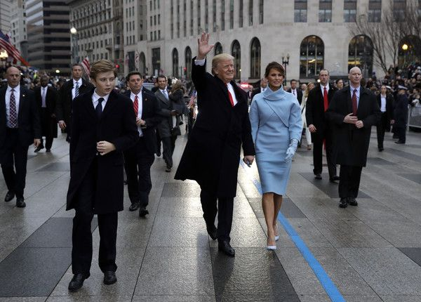 Melania Trump Photos Photos - U.S. President Donald Trump waves to supporters as he walks the parade route with first lady Melania Trump and son Barron Trump after being sworn in at the 58th Presidential Inauguration January 20, 2017 in Washington, D.C. Donald J. Trump was sworn in today as the 45th president of the United States - Parade Celebrates Presidential Inauguration Of Donald Trump