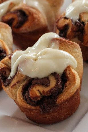 Nutella rolls with cream cheese icing. | 26 Delicious Things You Can Make With A Tube Of Biscuit Dough