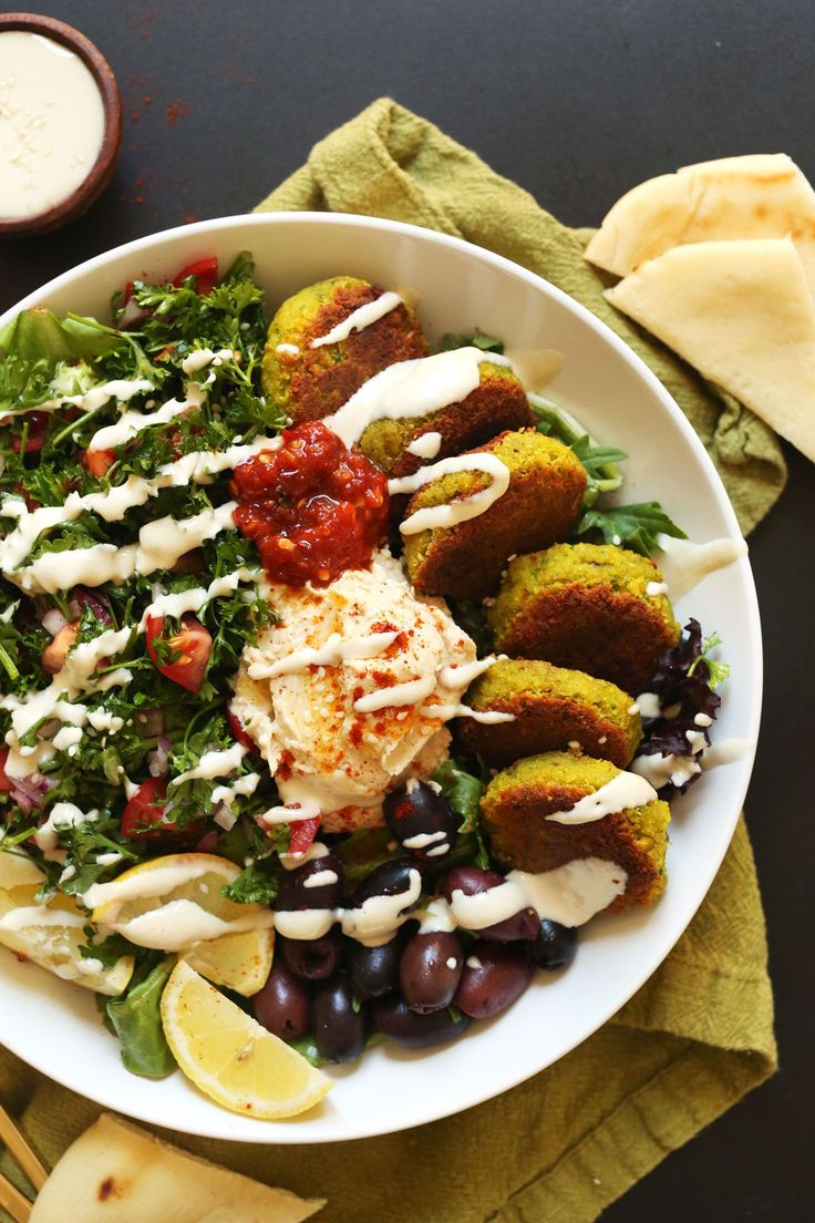The ULTIMATE Mediterranean Bowl with hummus, falafel, tahini sauce, olives, and pita! #vegan #glutenfree #falafel #recipe #healthy #easy #minimalistbaker