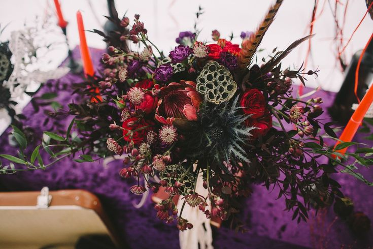 Bohemian wedding. Burgundy wedding bouquet, composed of Proteus, roses and other flowers. Registration was held under a beautiful branch, which we have decorated with floral decoration. Dreamcatchers also decorated the wedding in Boho style. Velvet tablecloth purple decorated wedding table. The candlestick was successfully complemented wedding decor. Photographer Olga Platonova, florist and decorator Christine Ageeva, wedding planner Agency Only you.