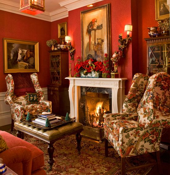 Holiday accessories find a home in this cheerful red room, where the mantel is festooned with cheerful poinsettias and berries. - Traditional Home ®/ Photo: John Bessler / Design: Anthony Catalfano