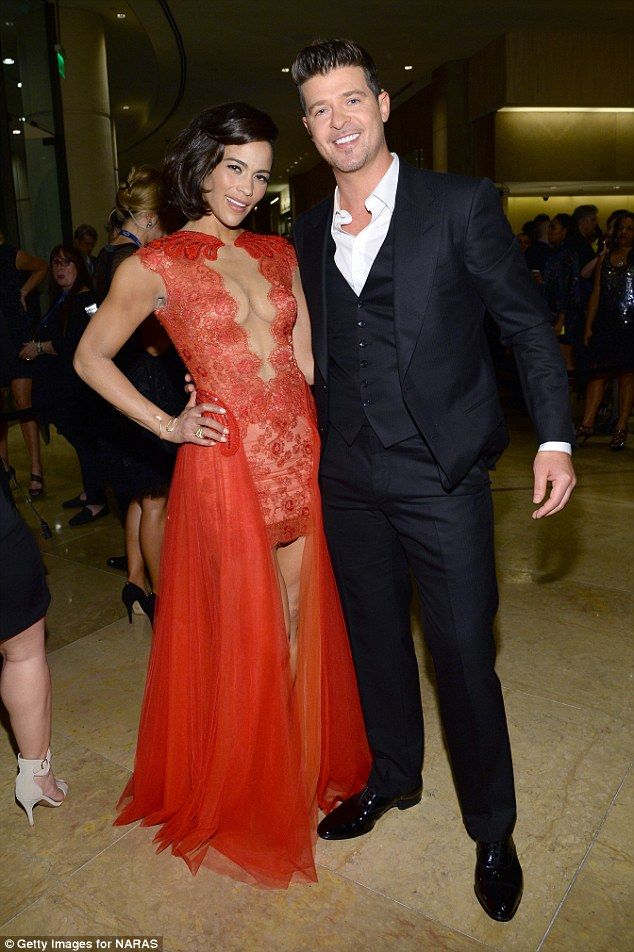 Tense: April's spate of sexy selfies comes amid an ongoing custody battle between Robin and his ex-wife Paula Patton (pictured) over their six-year-old son Julian