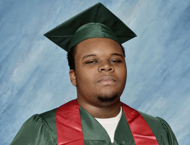 michael brown ferguson | Image: Michael Brown poses for a photo in his cap and gown taken in ...