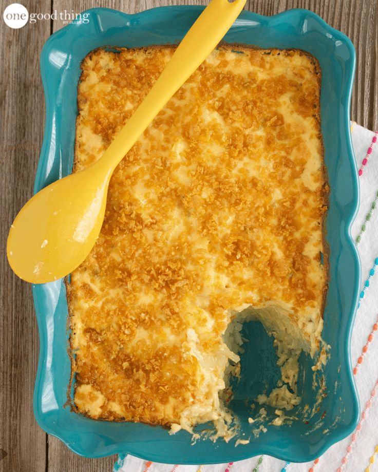 funeral potatoes  2 packages of Simply Potatoes shredded hash browns*  1 can cream of chicken soup  16 oz sour cream  2 cups cheddar cheese, grated  1/2 cup butter  1/3 cup green onions, finely chopped  1 cup corn flakes, crushed + 2 Tbsp melted butter