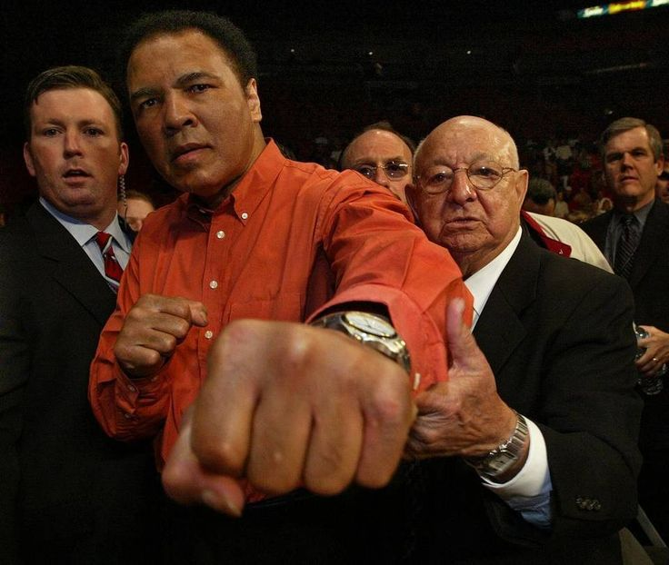 Dec. 21, 2002: During Friday Night Fights at the AmericanAirlines Arena Muhammad Ali, left, honors his former trainer Angelo Dundee with his presence during a ceremony honoring Dundee. Al Diaz Miami Herald