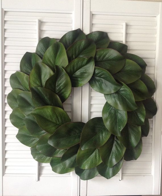 Magnolia wreath made with faux magnolia leaves. The wreath measures 18 in…