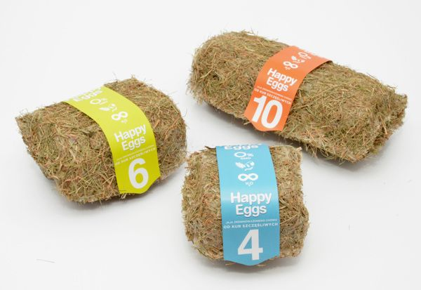 """Happy Eggs"" Maja Szczypek / Maja Szczypek designed eco-friendly cartons for organic eggs. The author decided to stick to the familiar dimpled form, best for this type of container, but used a different material. Thanks to her exclusive use of hay, the containers are pleasant to smell and touch. The boxes are available in different sizes, each accompanied by a special label. On the whole, the design is supposed to make the customer feel that what they have before them is 100% natural."