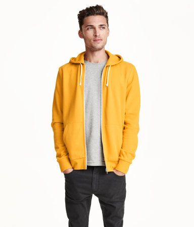 Jacket in sweatshirt fabric with a jersey-lined drawstring hood, zip at the front, front pockets and ribbing at the cuffs and hem.