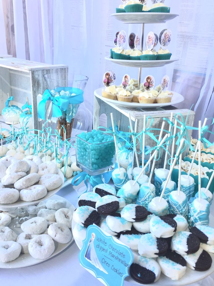 disney frozen dessert table white and turquoise dipped some oreos in white chocolate