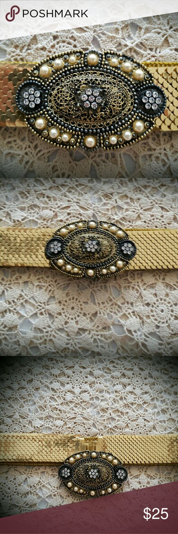 Gorgeous Rhinestone Belt Buckle & Gold Metal Belt This super cute gold metal belt is set off with a fabulous matching deachable rhinestone and pearl buckle.  A gorgeous  accessory in beautiful condition.  Women's size is 12-14. Accessories Belts