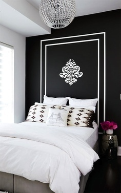 Gorgeous black and white wall with emblem used as headboard