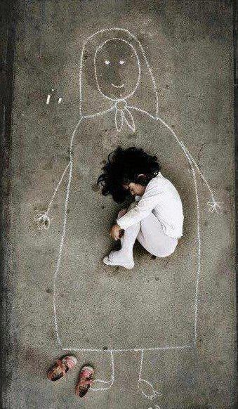 This is a child of an orphanage, she drew a mother on the floor and imagine herself falling into sleep in the warmth of mother's arms!