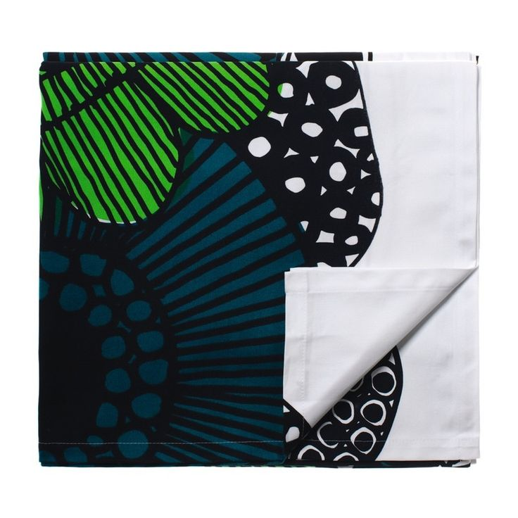 """Maija Louekari's siirtolapuutraha print  for Marimekko was inspired by a view of a cottage garden. """"Sirrtolapuutraha"""" is Finnish for """"allotment"""" & refers to the community cottage gardens alloted & enjoyed by city dwellers. Large blooms  that stun with their shape & beauty, enhanced with rich invigorating shades of greens & blues set against a white background & outlined in black. Bold & beauitful, this quality tablecloth makes dining a summery sensation."""