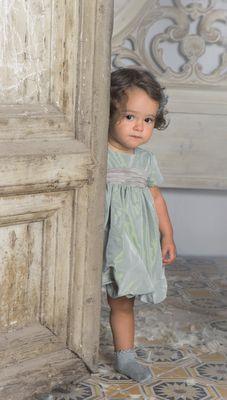 A darling in a luxurious powder blue velvet dress