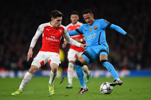 Neymar of Barcelona is challenged by Hector Bellerin of Arsenal during the UEFA Champions League round of 16, first leg match between Arsenal FC and FC Barcelona at the Emirates Stadium on February 23, 2016 in London, United Kingdom.