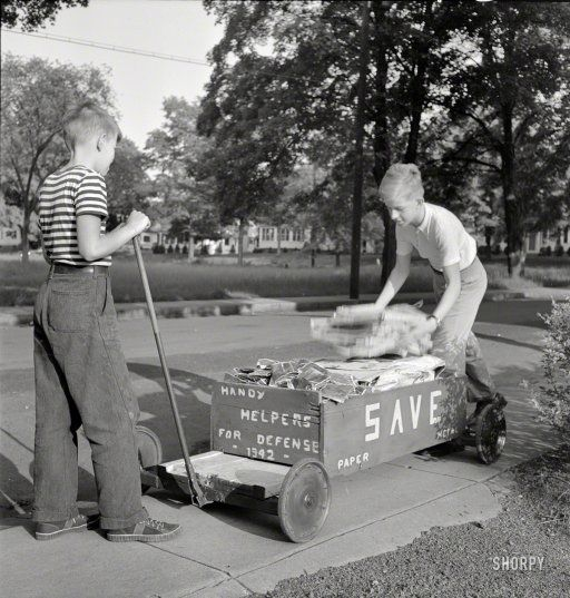 """May 1942. Southington, Connecticut. """"Boys collecting paper and metal for scrap drive."""" Photo by Fenno Jacobs for the Office of War Information. Prints from $15."""