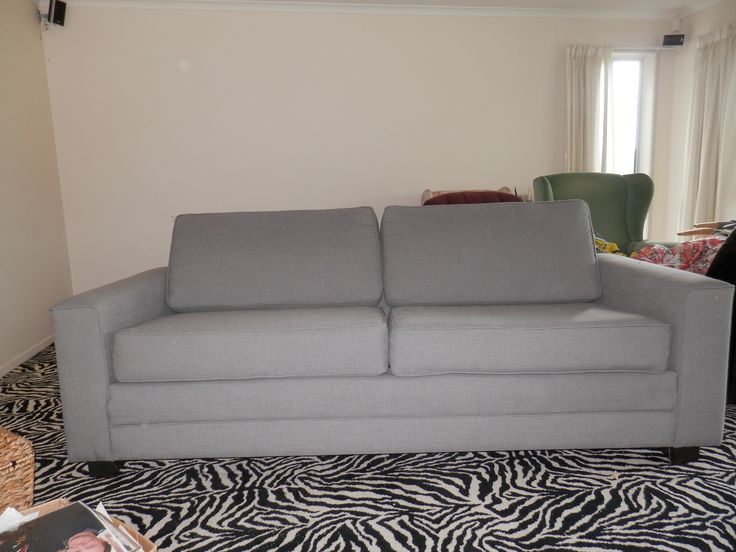 This grey linen three seater couch started life very very manky and had no squabs. now it looks great and my niece just loves it.