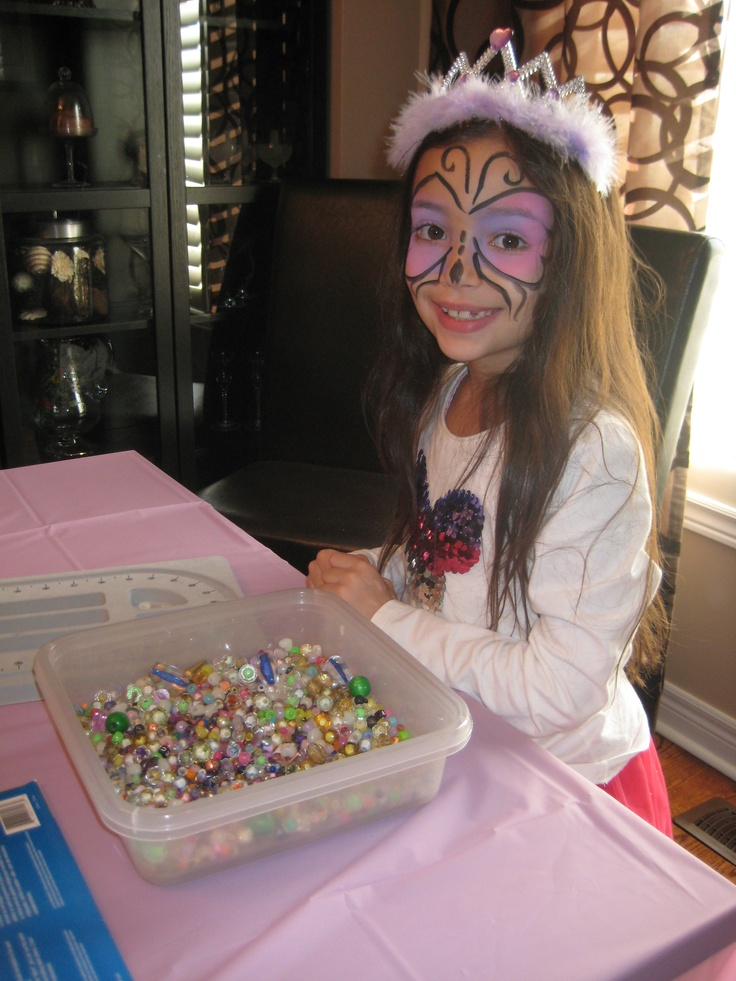 8 year old birthday girl picking her beads in bolton