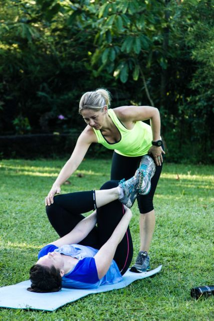 Stretching out with trainer Marni Alexander after a full training session. So important.