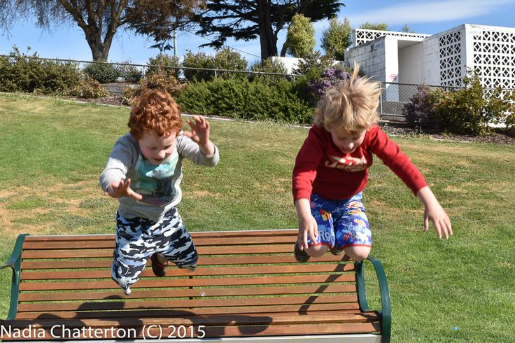 """L1M2AS3- Shutter Priority, attempt 2 at """"Frozen Motion"""" this time I was able to capture some motion of two children jumping from a park bench seat at the same time. I ensured my shutter speed was set to a more faster setting in order to maintain the boys frozen and clear while keeping the background clear also. Hand held Nikon D5500 f/11 1/250 ISO-200"""