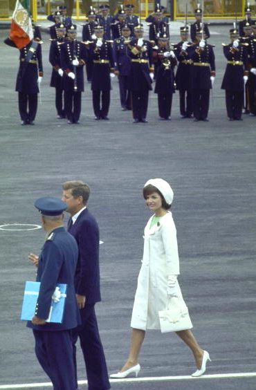 Jackie dressed all in white with President Kennedy in Mexico, July, 1962.