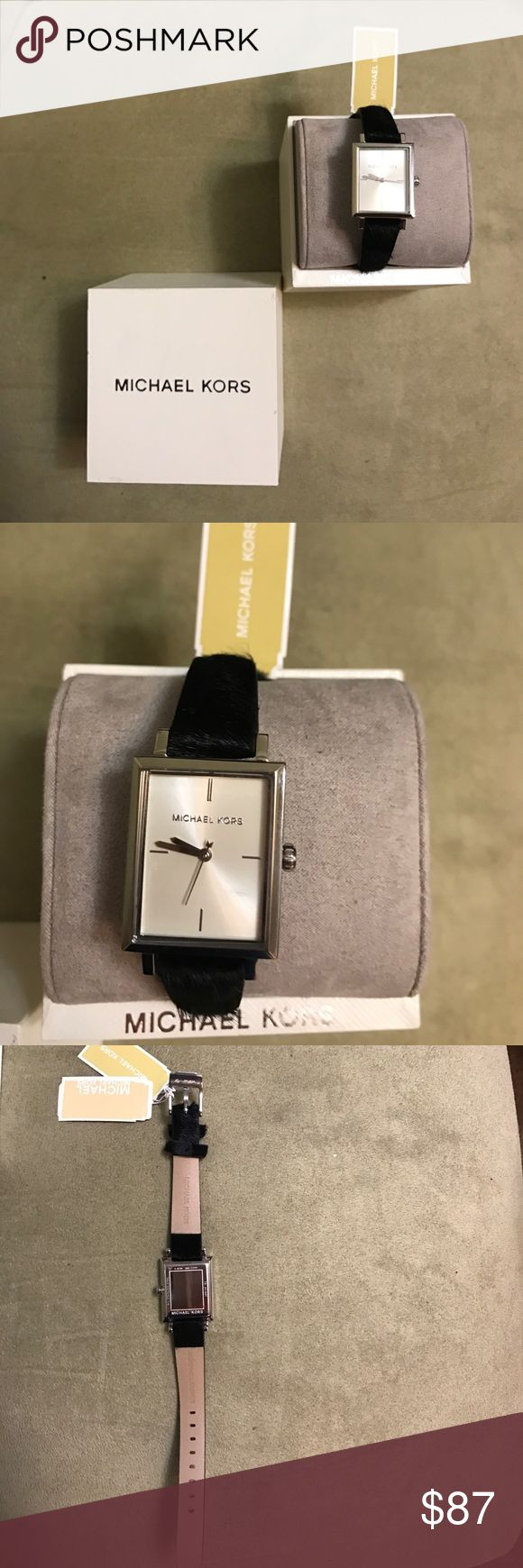 Michael Kors brand new ladies watch Details Stainless steel case with a black calfskin leather strap. Fixed bezel. Silver dial with silver-tone hands and index hour markers. Dial Type: Analog. Quartz movement. Scratch resistant mineral crystal. Pull / push crown. Solid case back. Case size: 24 mm. Case thickness: 8 mm. Square case shape. Buckle clasp. Water resistant at 50 meters / 165 feet. Functions: hour, minute, second. Casual watch style. Michael Kors Harway Silver Dial Ladies Watch…