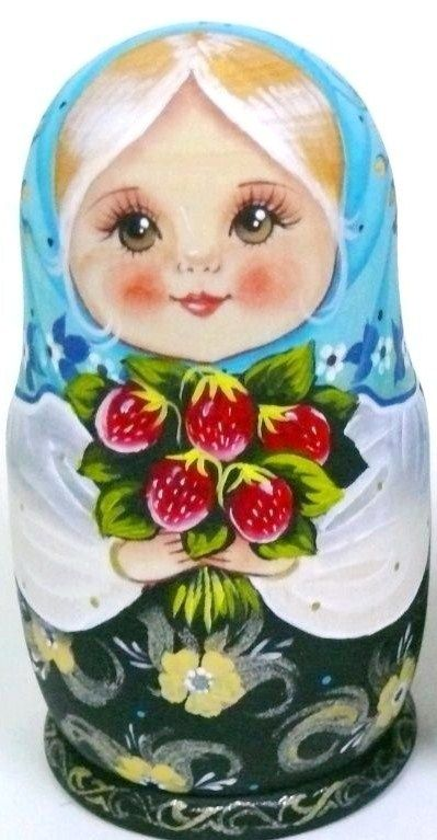 Matryoshka (Russian nesting doll) in a blue shawl holds a bunch of wild strawberries.