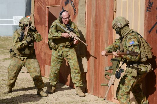 Former chief of the Australian Defense Force Major General David Hurley attempting to breach