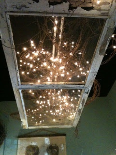old screen door hung overhead with lights and branchs-not sure about the mess but door is a good place to start.
