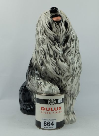 Top 25 Highest Selling Lots -Collectors & General Auction – Lot 664 – Beswick figure of a Old English Sheepdog with foot on Dulux paint tin 1990 height 32cm.  Sale Price £240.00