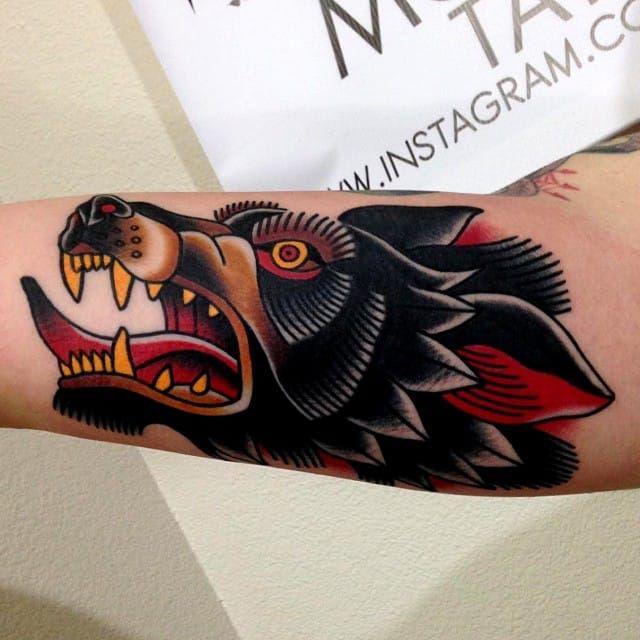 Traditional Wolf Tattoo by Jonathan Montalvo @montalvotattoos jonathanmontalvo montalvotattoos traditional wolf